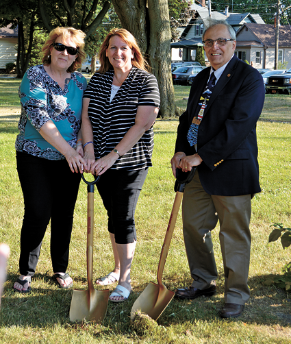 Project co-chairs MaryBeth Kupiec (left) and Paula Benedyczak break ground at Brauer Park alongside North Tonawanda Mayor Arthur G. Pappas.