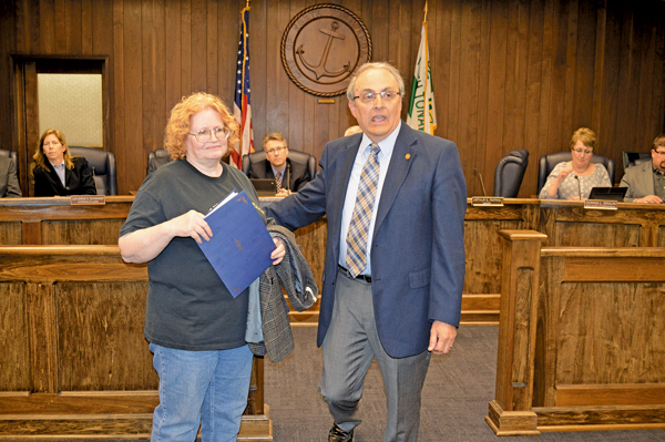 Pamela Hill accepts a proclamation from Mayor Art Pappas on behalf of Meals on Wheels.