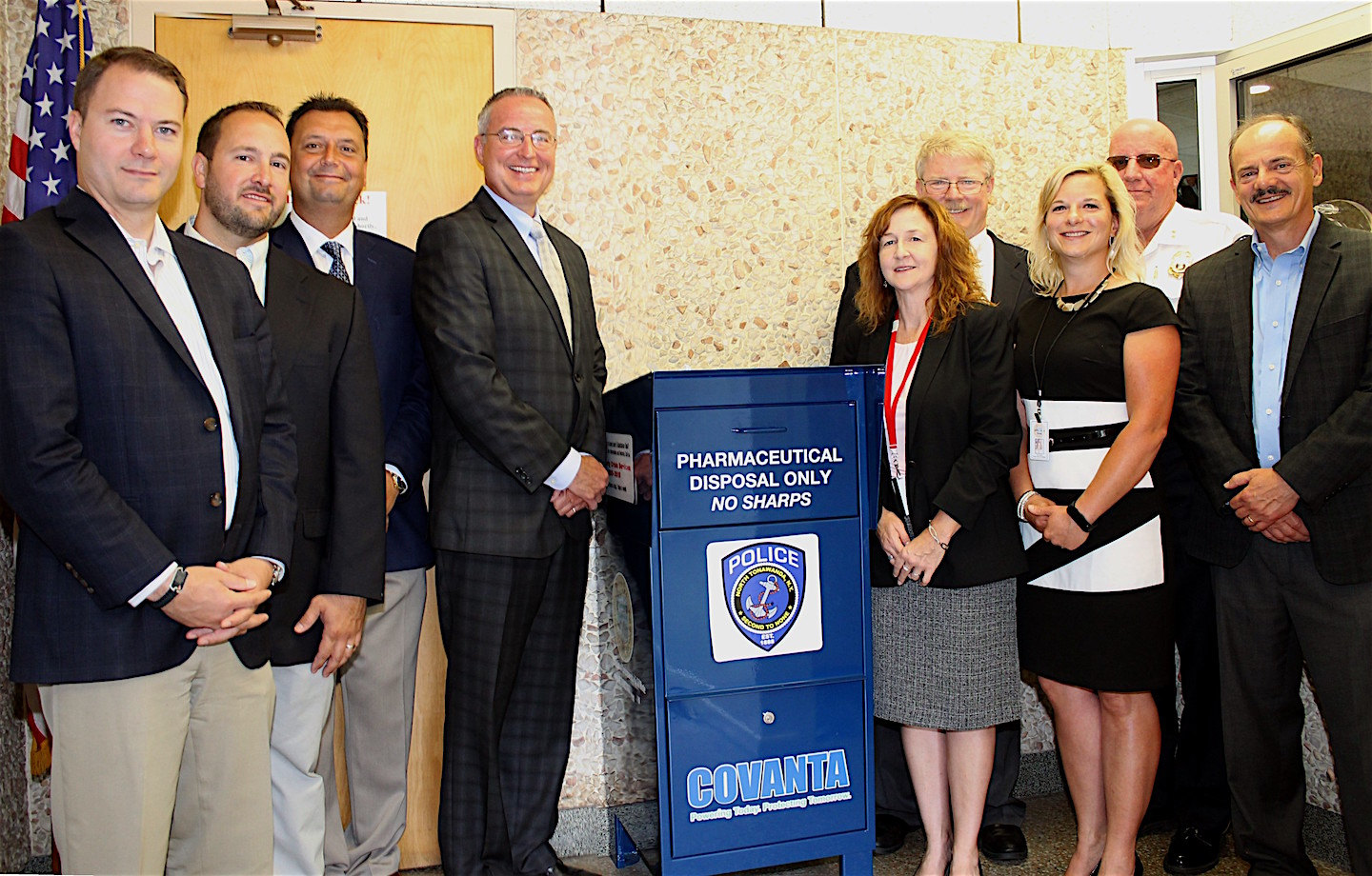 North Tonawanda community leaders gather around a pharmaceutical collection bin located at the North Tonawanda Police Department, 216 Payne Ave., that was dedicated this morning and allows residents to dispose of prescription drugs safely. From left are Sen. Robert G. Ortt, Niagara County Legislator Rich Andres, majority leader Randy R. Bradt, Niagara County Director of Public Health Director Dan Stapleton, Niagara County Director of Mental Health Laura Kelemen, Covanta Niagara Business Manager Kevin O'Neil, Niagara County Environmental Coordinator Dawn Timm, North Tonawanda Police Chief William R. Hall, and Horizon Health Services Treatment Specialist Bill Bly.