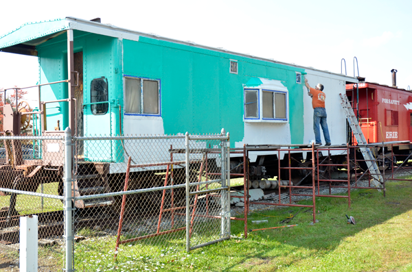 Railroad Museum of the Niagara Frontier member Marcus Gillebaard completes restoration work on a caboose at the museum. A barbecue will be held onsite Oct. 8 to raise funds for this restoration project as well as others at the museum.