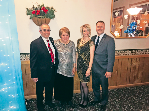 North Tonawanda Mayor Arthur G. Pappas, far left, poses for a photo with his wife, Linda, as well as New York State Sen. Robert G. Ortt (far right) and his wife, Meghan, at the annual Charity Snowflake Ball.