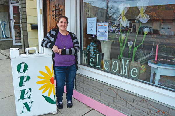 Amy Sileo stands outside of her business, Sherwood Florist, at 458 Oliver St.