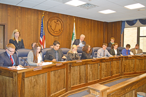 From left, sitting, are students James Hutton, Katrina Bonefede, William Alvarado, Allie Eckstein, Abigail Giambra, Jacob Lemke, Karylin Rivera and Joe Kraus. Standing are aldermen Cathy Schawndt, Russ Rizzo and Donna Braun.