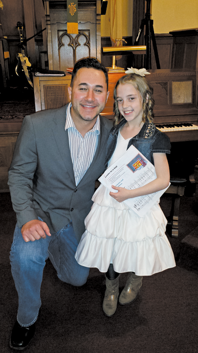 Alyssa Marella is shown with her voice instructor, Zach Carr of Matt's Music in North Tonawanda. Marella will perform at Carnegie Hall in December after placing in an international voice competition. (Contributed photo)