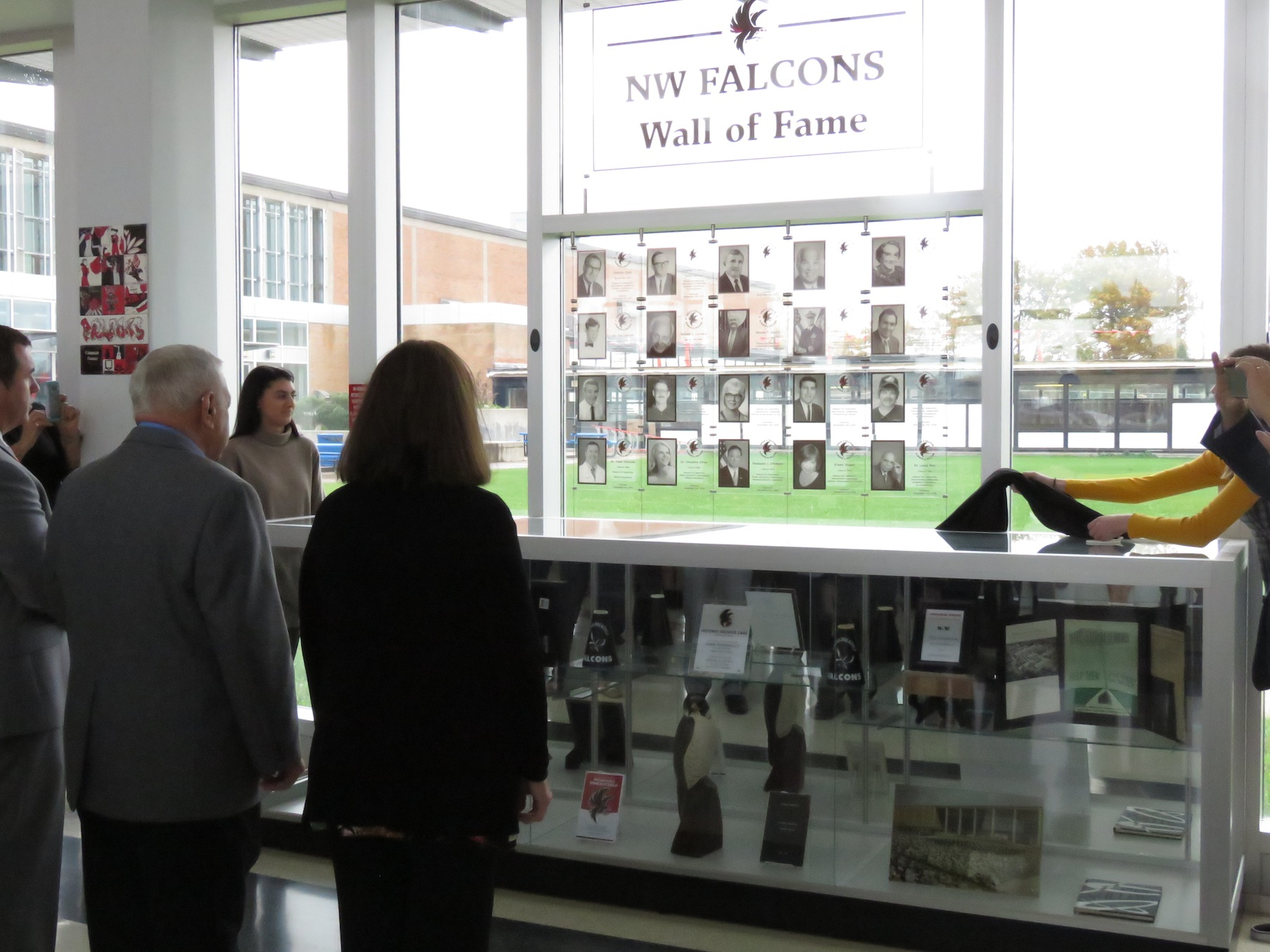 Newly inducted members see their faces on the Falcon Wall of Fame. (Photos by David Yarger)