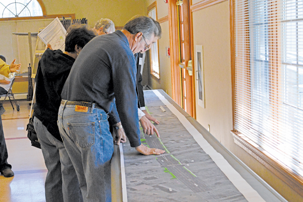 Residents examine a map of a planned Niagara Falls Boulevard reconstruction project.