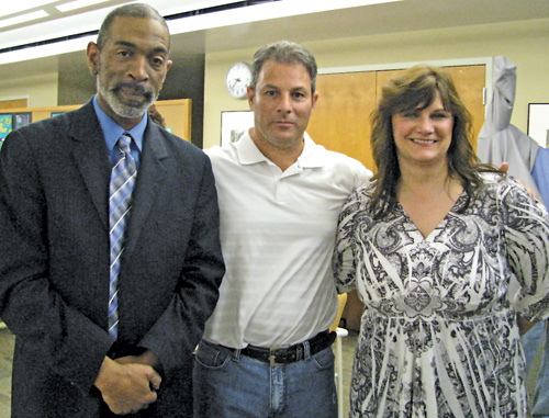 Shown from left are the three newly elected Niagara-Wheatfield Board of Education members: Darren Sneed, incumbent Christopher Peters and Gina Terbot.