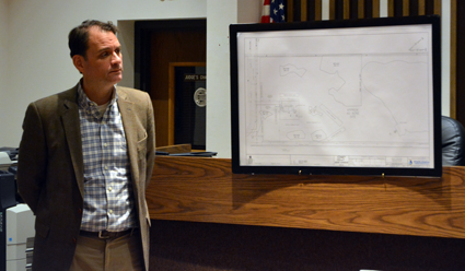 Attorney Adam S. Walters, representing National Fuel, stands with dehydration facility's initial sketch plan.