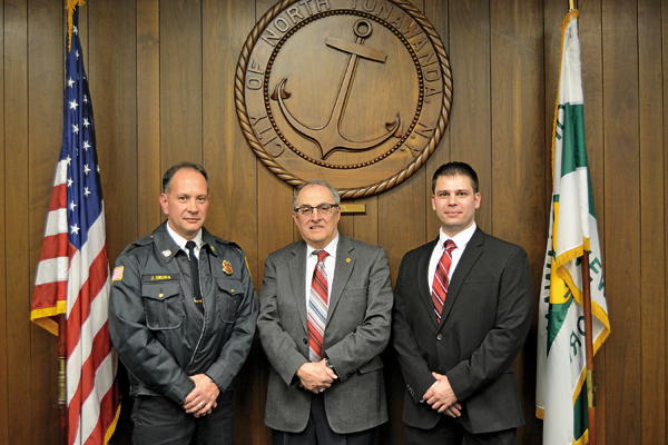 City of North Tonawanda Mayor Arthur G. Pappas, center, stands proud with the city's newly appoint fire chief, Joseph Sikora (left) and his new administrative assistant, Peter Drossos. (Photo by Lauren Zaepfel)