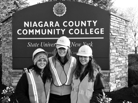 Rotaract members pose for a photo together while cleaning up a part of Route 31. From left, are Leah Sidote, Morgan Brown and Lara Bax.