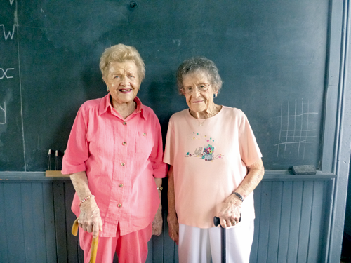 Lillian DuBois and Edna Walck of the Town of Niagara attended Niagara School No. 2, now a museum, when they were children. (Photo by Jill Keppeler)