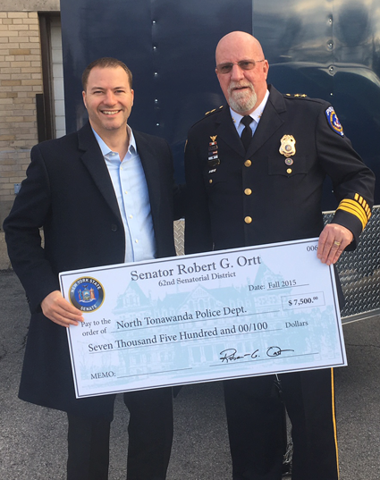 State Sen. Rob Ortt, left, is pictured with North Tonawanda Police Chief William Hall in front of the new trailer purchased with a portion of the $7,500 in state funds Ortt secured for the company.