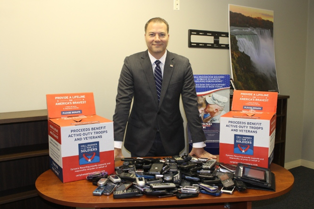State Sen. Robert Ortt stands with donated items.
