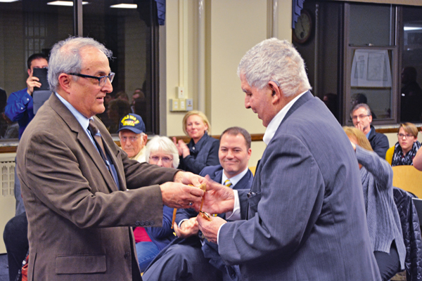City of North Tonawanda Mayor Arthur G. Pappas presents Phillip R. `Russ` Rizzo with a key to the city. (Photo by Lauren Zaepfel)