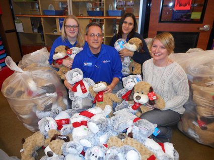 Pictured, from left, are PetSmart Salon Manager Shauna Gardener, Store Leader Paul Wargula, Customer Engagement Leader Jen Mages and Child Advocacy Center Safe Harbour Coordinator Megan Genson.