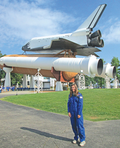 Holy Ghost Lutheran School teacher Sara Poreda is shown in front of the Space Shuttle Pathfinder.