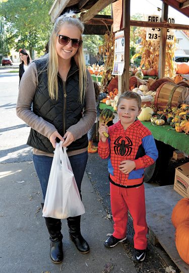 Allie Eckstein and Robert Stahlman (as Spiderman) of North Tonawanda pick out some small gourds.