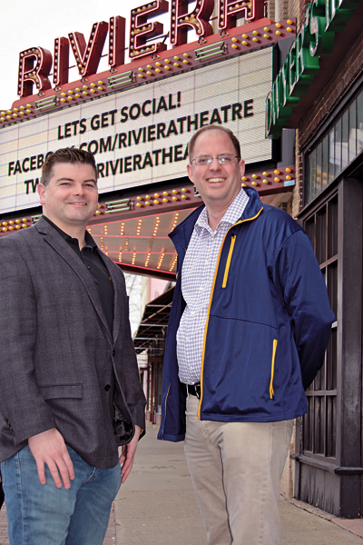 Riviera Theatre co-directors Gary J. Rouleau and Jim Pritchard stand together in front of the marquee.