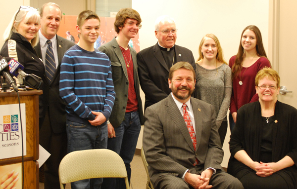 From left, standing, are Katie and Jake Schneider, 2015 appeal chairs; students John Bluff and Michael Jeswald; Bishop Richard J. Malone; and students Melissa DiVirgilio and Madeline Miller. Seated are Catholic Charities CEO Dennis C. Walczyk and Catholic Charities Diocesan Director Sister Mary McCarrick.