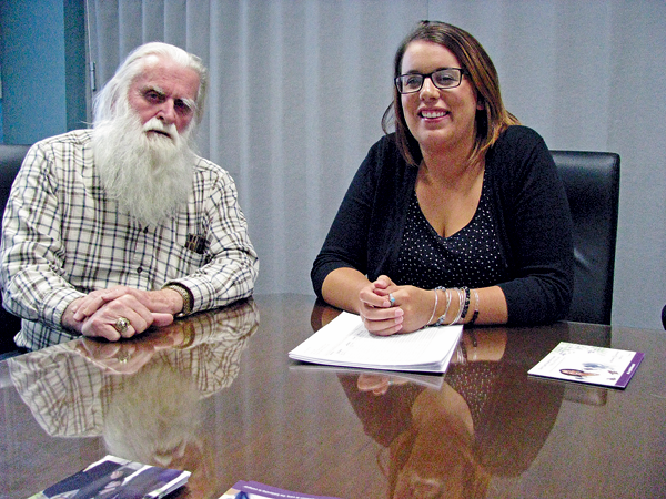 Charles Flay of Sanborn, left, was among those attending the Alzheimer's Association of Western New York caregivers support group last month at Mount St. Mary's Hospital and Health Center in Lewiston. At right is Shelby Edgerly, Alzheimer's Association director of early stage services and support groups. (Photo by Susan Mikula Campbell)