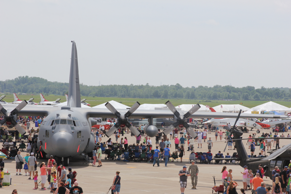Shown is a C-130 military aircraft surrounded by spectators at the Thunder of Niagara Air Show. (File photo)