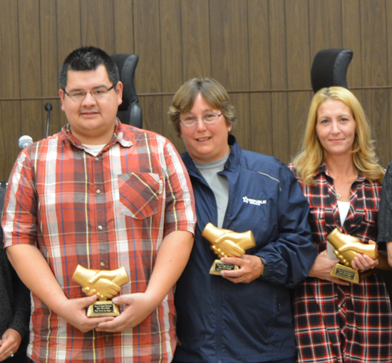 Summer volunteer coaches, from left, Corey Hewitt, Pam Scott and Lisa Sembert pose with awards presented to them by the Town of Niagara Town Board and Recreation Department.