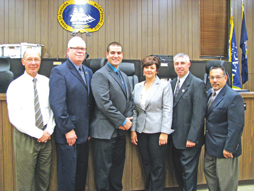 Town of Niagara resident Hagop Jake Otabachian, third from left, is congratulated by Deputy Supervisor Sylvia Virtuoso and the Town Board as a new full-time officer for the Town of Niagara Police Department.