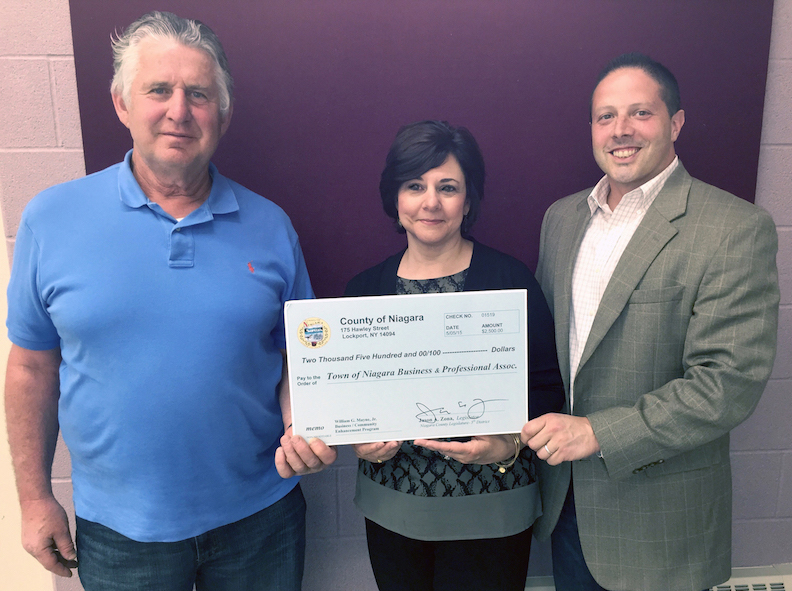 From left, Gary Strenkoski and Sylvia Virtuoso receive a Niagara County grant from Legislator Jason Zona.