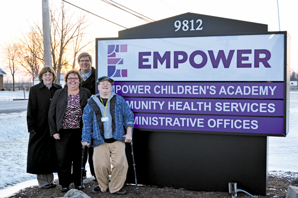 Employees of Empower stand together by the organization's new sign on Lockport Road. From left: Chief Financial Officer Rita Tweedie, Director of Program Operations and Quality Assurance Dian Baehre, Executive Director Jeff Paterson and Second Vice President Board of Directors Dan Vitch. Empower was named Employer of the Year by the Town of Niagara Business and Professional Association.
