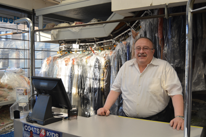 Russ Petrozzi, owner of Capitol Cleaners, stands at the front desk.