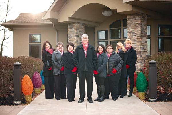 Dr. Salvatore Manente, owner of Manente Orthodontics, poses for a photo with his employees outside of his business at 2840 Military Road. Manente Orthodontics is set to be honored as Employer of the Year at the Town of Niagara Business and Professional Association's annual dinner and awards ceremony on Jan. 25. (Photo courtesy of Manente Orthodontics)