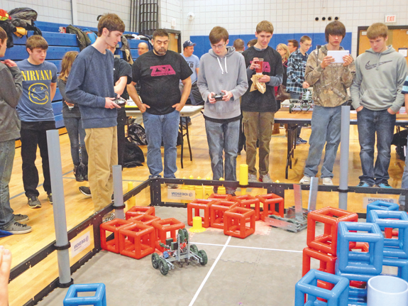 Students compete in a robotics competition. (photo by Autumn Evans)