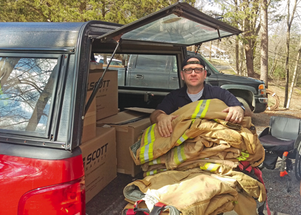 Michael DiPasquale of Adams Fire Co. loads up a vehicle with used firefighter gear for companies in need in rural Tennessee.
