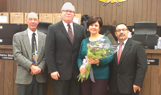 Pictured, from left, Councilmen Danny Sklarski and Marc Carpenter and Councilman Charles Teixeira present Interim Supervisor Sylvia Virtuoso with flowers.