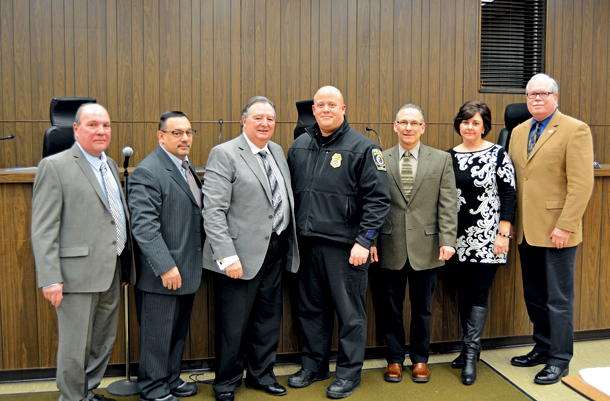 Newly appointed Town of Niagara Police Capt. Craig Guiliani (center) stands alongside Town Board members, from left, Councilman Richard A. Sirianni, Deputy Supervisor Charles F. Teixeira, Supervisor Lee S. Wallace, Councilman Samuel S. Gatto, Town Clerk Sylvia Virtuoso and Councilman Marc M. Carpenter.
