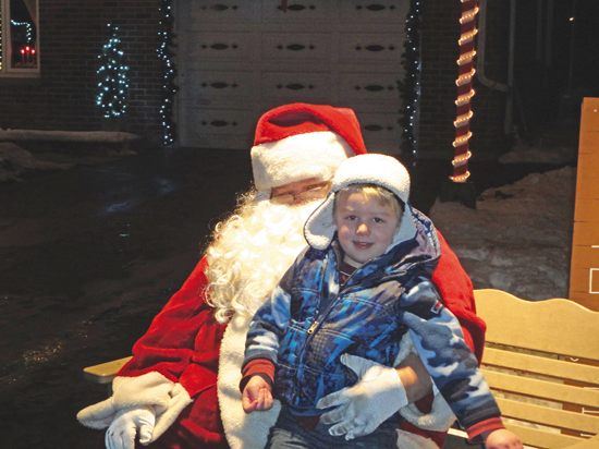 Santa visits with Adam Fezer, 4.