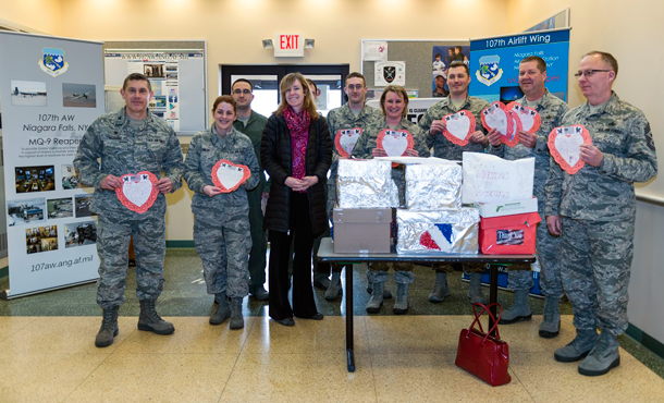 Airmen and women showcase their Valentine's Day cards presented by Erie County Legislator Lynne Dixon. The cards were made by children from more than 35 Erie County schools. (U.S. Air National Guard photos by Staff Sgt. Ryan Campbell)