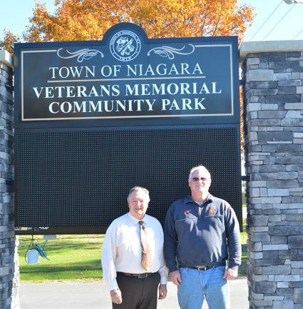 Town of Niagara Supervisor Lee Wallace (left) stands with Mark Dembitsky of Town of Niagara Active Hose Co. in front of the soon-to-be finished sign for the newly named