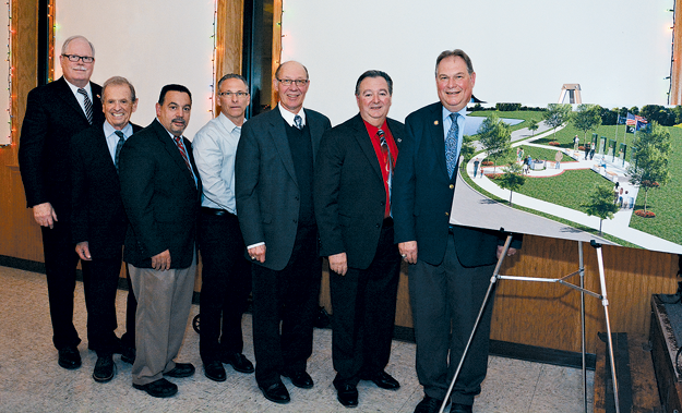 Officials stand with a rendering of a veterans memorial and walkway for the Town of Niagara's Veterans Memorial Community Park. Shown are, from left: Councilman Marc M. Carpenter, Richard Soluri representing New York State Sen. Robert G. Ortt, Councilman Charles F. Teixeira, Councilman-elect Sam Gatto, Councilman Danny Sklarski, Supervisor Lee S. Wallace and Assemblyman John D. Ceretto. (Click for a larger image; photos by Marc Carpenter)