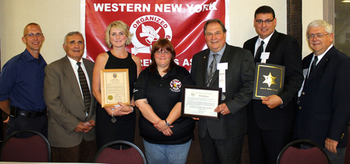 Niagara County leaders came out in force Wednesday night to welcome volunteer firefighters and EMS workers. Pictured, from left, are Niagara County Fire Coordinator Jonathan Schultz, Niagara County Legislature Chairman William L. Ross, Legislator Kathryn Lance, WNYVFA President Wendi Walker, Assemblyman John D. Ceretto, Sheriff James R. Voutour and Wheatfield Supervisor Robert B. Cliffe.