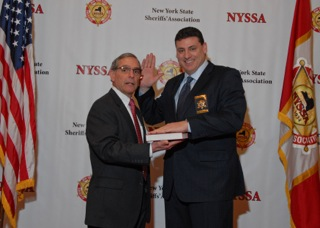 Niagara County Sheriff James Voutour (right) is sworn in as 2nd vice president of the New York State Sheriffs' Association by Chemung County Executive Tom Santulli at the Sheriffs' Association's 80th annual Winter Training Conference at the Desmond in Albany. (photo by Thomas F. Rocco)