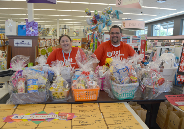 North Tonawanda's Walgreens Assistant Store Manager Michelle Vago stands beside Store Manager Rob Grosskopf with donated gift baskets for the raffle to take place during the store's Customer Appreciation Day. (Photo by Lauren Zaepfel)