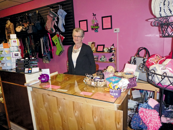 Michele Krienbuhl stands behind the counter at Michele's Motif on Webster Street, North Tonawanda. The store recently opened at the site of the former Hodgepodge Gifts.