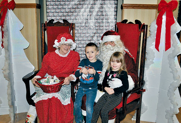Children visit Santa and Mrs. Claus during a Christmas party held at the community center in Wheatfield. (Photos by Walt Bissett)