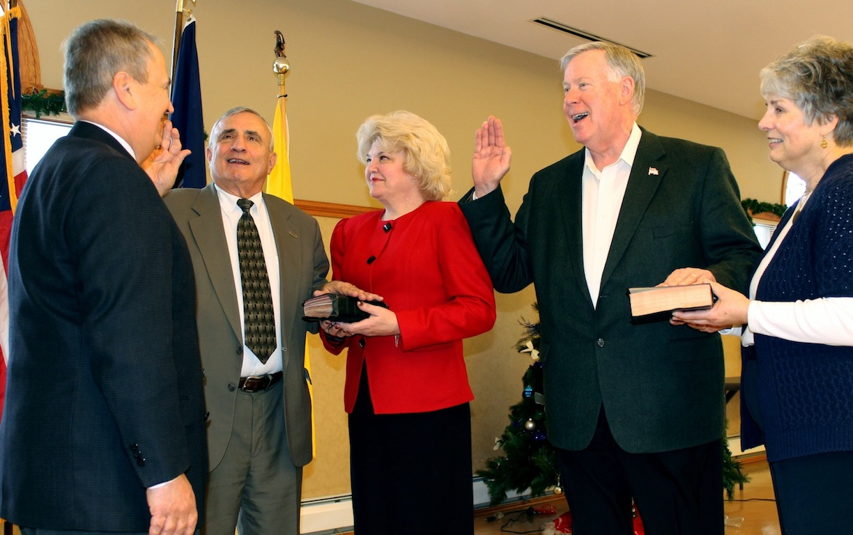 Wheatfield inauguration: State Sen. George D. Maziarz, R-Newfane, administers the oath of office to two of Wheatfield's three county lawmakers Wednesday at the Wheatfield Community Center. Taking their oaths are Legislator William L. Ross, C-Wheatfield, whose wife, Linda, is holding the family Bible, and Legislator Dave Godfrey, R-Wilson, whose wife, Julia, who is also Wilson's elected tax collector, holds their family Bible. Not pictured is Legislator Kathryn Lance, R-Wheatfield, who was also at Wednesday's inaugural festivities at the red, white and blue bunting-bedecked community center.