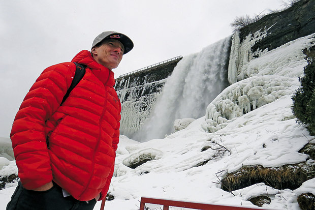Will Gadd is pictured at the base of the Cave of the Winds in front of a less-frozen falls. (Photos by Joshua Maloni)
