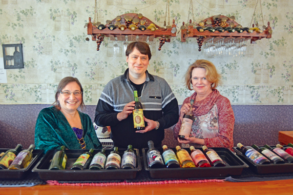 Margo Sue Bittner (left), owner of the Winery At Marjim Manor, and the Niagara Wine Trail event committee chairwoman, smiles alongside wine servers Joseph Budnack and Kim Seddon as they hold two of the winery's gold medal wines: Sophia's Sunrise and Lady of the Manor. Both will be featured at the upcoming `Taste of the Trail` event. (Photos by Lauren Zaepfel)