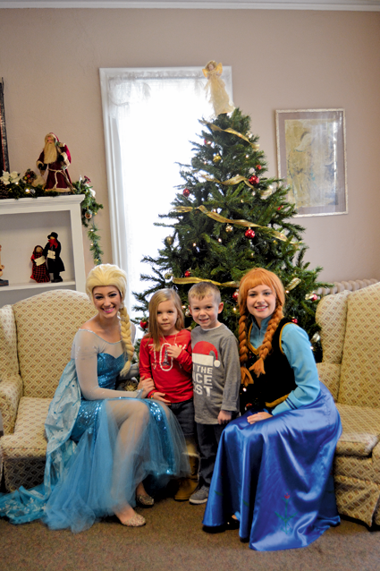 "Posing for a photo with Disney's ""Frozen"" stars Anna and Elsa."