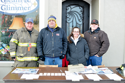 "Members of Sweeney Hose Co. No. 7 sell raffle tickets for the ""A Christmas Story"" event to raise money for the firehall. From left: Joe Lavey, Peter Schenier, Jamie Doeing and Kyle Reeves."