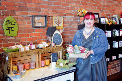 Heather Kalisiak presents holiday-shaped soaps among several other homemade bath and body products.